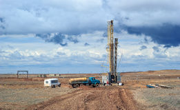 Drilling rigs. Operate in the steppe in the spring Royalty Free Stock Image