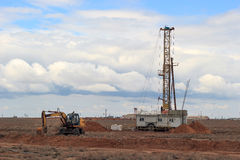 Drilling rigs. Operate in the steppe in the spring Royalty Free Stock Photo