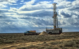 Drilling rigs. Drilling rigs operate in the steppe in the spring Stock Photos