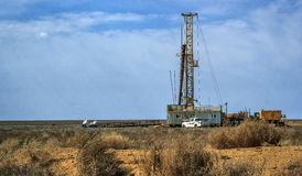 Drilling rigs. Drilling rigs operate in the steppe in the spring Stock Image