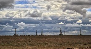 Drilling rigs. Drilling rigs operate in the steppe in the spring Royalty Free Stock Image