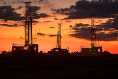 Drilling rigs. Operate in the steppe at sunset Stock Image