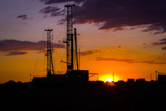 Drilling rigs. Operate in the steppe at sunset Royalty Free Stock Image