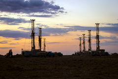 Drilling rigs. Operate in the steppe at sunset Royalty Free Stock Photography