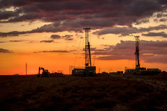 Drilling rigs. Operate in the steppe at sunset Royalty Free Stock Photos