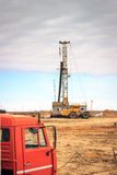 Drilling rigs. Operate in the steppes of Southern Kazakhstan in the spring Stock Photos