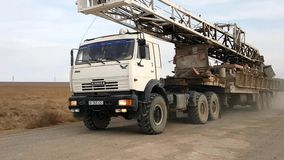 Drilling rigs. The drilling rig is moved across the steppe of southern Kazakhstan on the truck stock footage