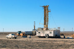 Drilling rigs. And special equipment work in the steppe Royalty Free Stock Image