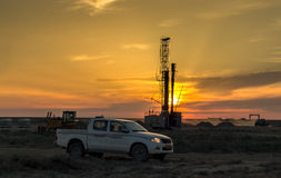 Drilling rigs at sunset. Drilling rigs operate in the steppe at sunset Stock Photos