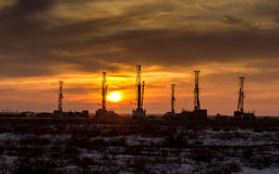Drilling rigs. Sunset in South Kazakhstan steppe in the winter stock photo