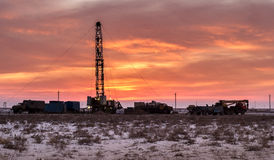 Drilling rigs. Sunset in South Kazakhstan steppe in the winter stock photography