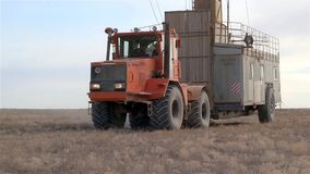 Drilling rigs. Wheeled tractor transporting a drilling rig on the steppes of southern Kazakhstan stock video footage