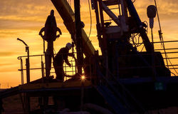 Drilling rigs. Work does work on the rig at sunset royalty free stock photography