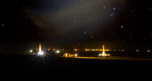 Drilling rigs. Work in the steppe at night Stock Photos