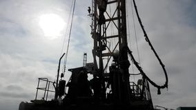 Drilling rigs. Workers work on a drilling rig in the desert stock footage