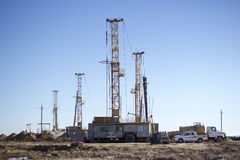 Drilling rigs working in the desert Stock Photo