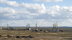 Drilling rigs working in the steppe Stock Image
