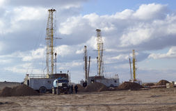 Drilling rigs working in the steppe Royalty Free Stock Images