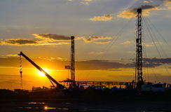 Drilling rigs. Drilling rigs are working in the steppes of southern Kazakhstan Stock Photos