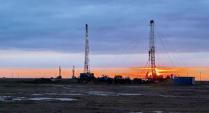 Drilling rigs. Drilling rigs are working in the steppes of southern Kazakhstan Royalty Free Stock Image