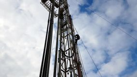 Drilling rigs. Working up the stairs to the rig mast. South Kazakhstan stock video
