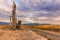 Drilling rock in the works of creating a road stock images