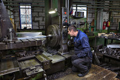 Drilling of steel parts in  turning shop metal factories. Stock Image