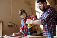Drilling together Royalty Free Stock Images
