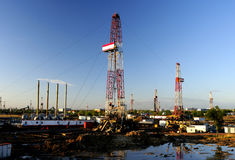 Drilling tower. Oil derrick pumps oil or natural gas from underground Stock Photography
