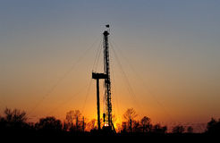 Drilling tower. In the evening sky into the orange , drilling tower into a silhouette Royalty Free Stock Image
