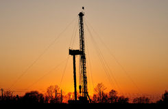 Drilling tower. In the evening sky into the orange , drilling tower into a silhouette Royalty Free Stock Photo