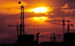 Drilling tower and construction crane Stock Images