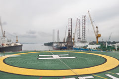 Drilling Units Behind Helicopter Deck Royalty Free Stock Photography