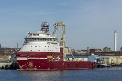 Drilling vessel Dina Polaris docked in New Bedford. New Bedford, Massachusetts, USA - April 24, 2018: Geotechnical drilling vessel Dina Polaris, hailing port royalty free stock photography
