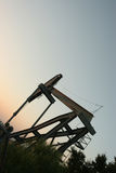 Drilling with a view. Oil drilling rig in the sunset Royalty Free Stock Photo