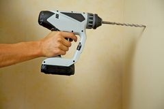 Drilling a wall Royalty Free Stock Photos