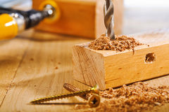 Drilling of wooden board Royalty Free Stock Photo
