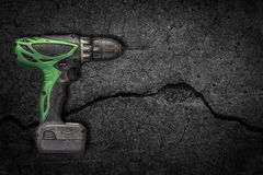 Drills with background cracking Royalty Free Stock Images