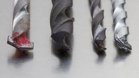 Drills. Four different drills on brushed-silver ground royalty free stock photography