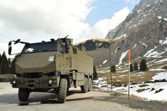 Drills of the Swiss army. Swiss army has regular drills in the beautiful regions of the country. Soldiers and military machines was gathered in a lonely place in royalty free stock image