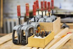 Drills and woodworking tools at workshop Royalty Free Stock Photos