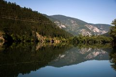Drina river. In Bosnia and Herzegovina. River in the mirror. Peace, silence, rest for soul and body royalty free stock images