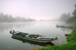 Drina rivet near Bajina Basta - autumn picture. Drina river near Bajina Basta, autumn picture. There are a two boats in front of the photography and mist in the royalty free stock image