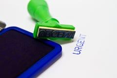 Dringende stamper Stock Foto's