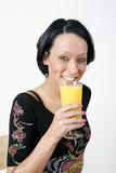 Dringing orange juice Stock Images