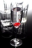 Drink. With cherry in champagne glass Royalty Free Stock Photography