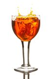 Drink. Fresh drink leaping and splashing from a wine glass Stock Photography