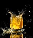 Drink. Splash drink with black background Stock Photos