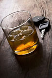 Drink. (don't) drink and drive -  glass of liquor and car keys on a bar Stock Photography