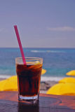 Drink. A glass of drink on the beach Royalty Free Stock Image